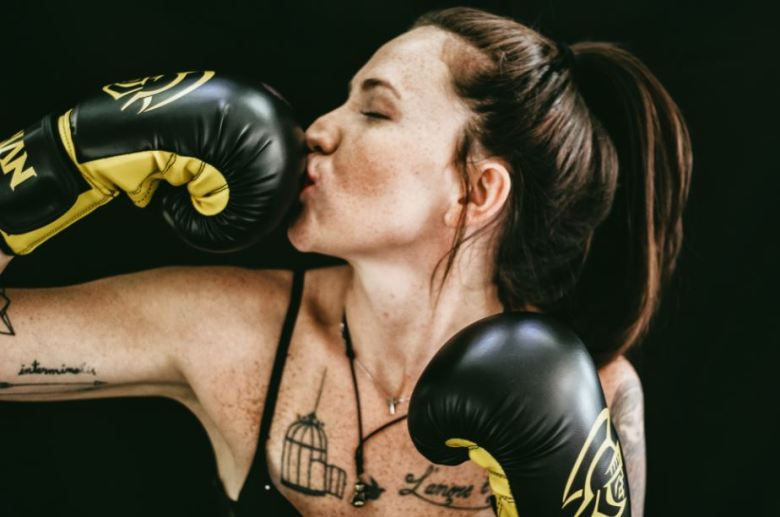 Woman kissing boxing gloves success.JPG